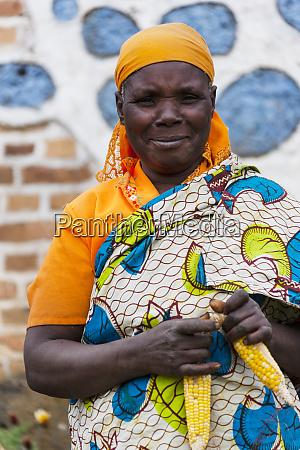 africa rwanda ruhengeri woman tying together