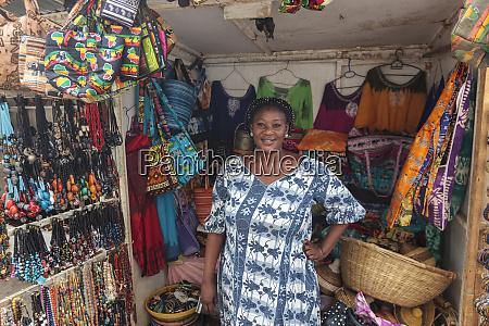africa senegal dakar smiling woman selling