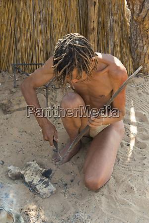 bushman using animal bones to make