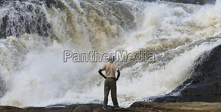 tourist watching murchison falls uganda