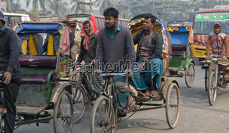 colorful rickshaws on the street dhaka