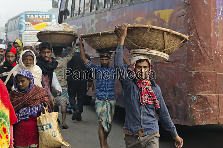 man carrying basket on the head
