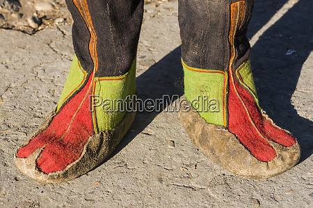 feet of monk in traditional costume