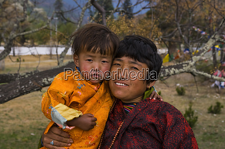 mother with her son paro tshechu