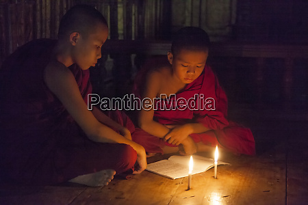 myanmar mandalay novice monks studying by