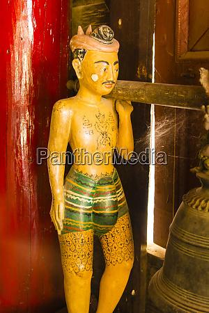 myanmar mandalay carved wooden figure in