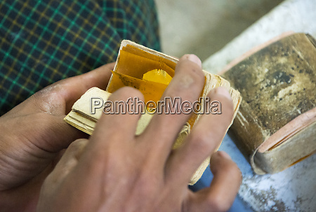 packaging gold leaves at a jewelry
