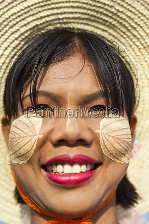thanakha paste patterns on face to