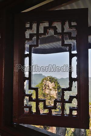view through window at mountains of