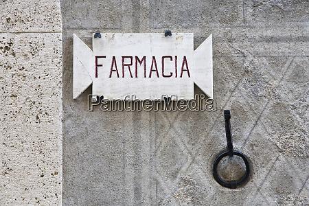 italy tuscany pienza pharmacy sign on