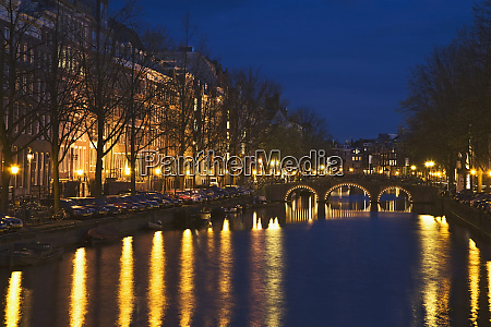 netherlands amsterdam bridge and lights reflect