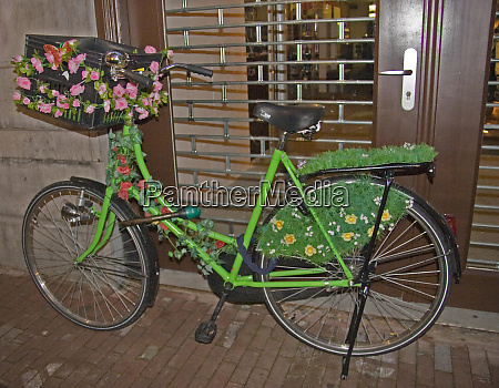 a brightly decorated green bicycle with