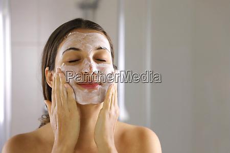 skincare woman washing face foaming