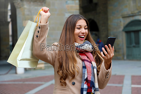 happy excited shopper woman laughs watching