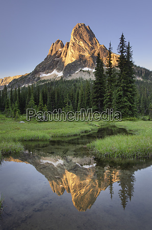 liberty bell mountain reflected in still