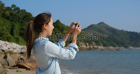 woman take photo on cellphone with