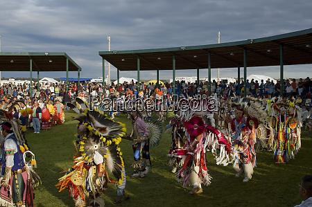 colorful pow wow dancers and participants