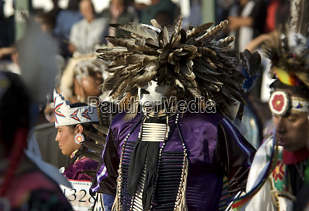 traditional mans pow wow dancer dressed