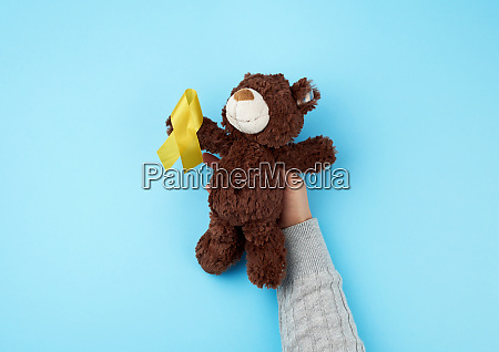small brown teddy bear which holds