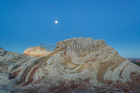 moon at sunrise vermillion cliffs white