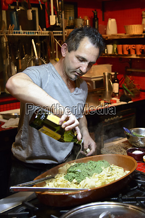 chef pouring olive oil mr