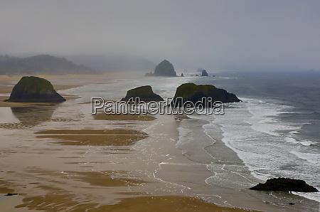 usa oregon cannon beach fogy morning