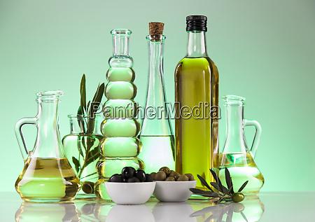 cooking olive oils bottles background