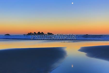 usa oregon bandon beach moonset at