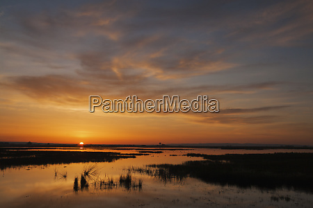 sunrise over western prairie pothole ponds