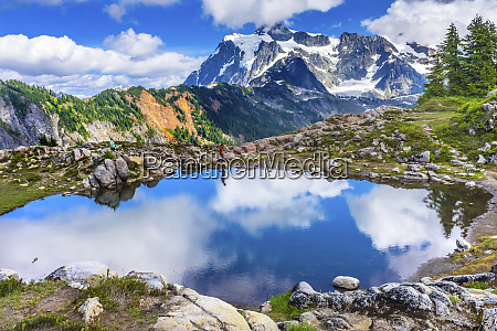 hikers, on, mount, shuksan., pool, reflection - 27807120