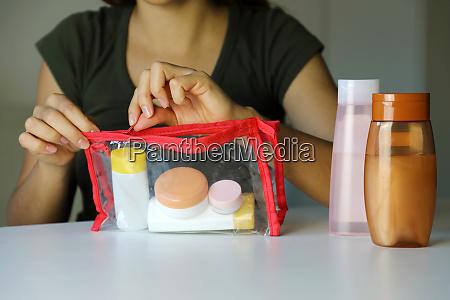 woman prepare travel kit for transporting
