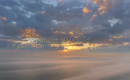 sunset clouds over lake michigan at