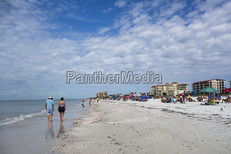tourists and people walking on clearwater