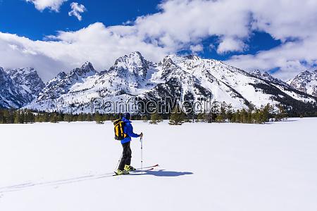 backcountry skier under the tetons grand