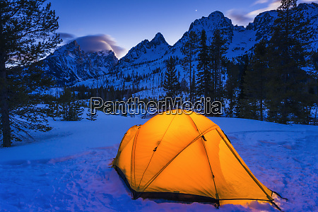 winter camp at dusk under the