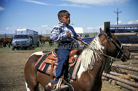 blackfeet elementary age boy in saddle