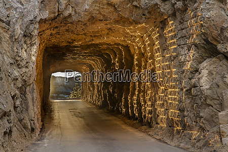 tunnel on iron mountain road lit