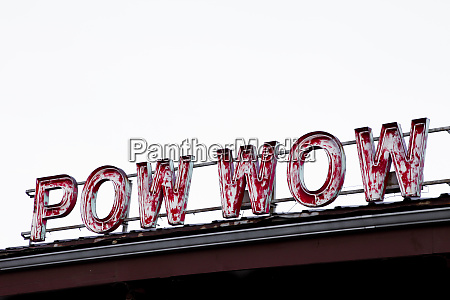 neon pow wow sign