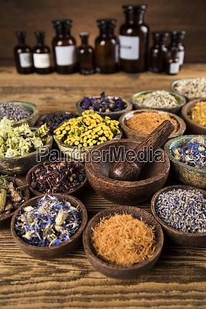 herbs medicine and vintage wooden background