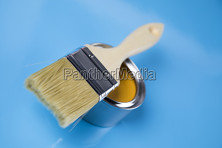 tin cans with paint brushes and