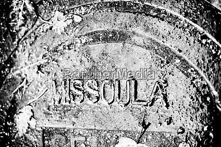 rain covered manhole cover in missoula