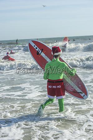 surfing santas elf cocoa beach florida