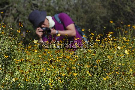 photographer in butterfly garden