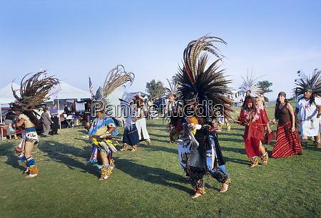 large group of aztec dancers display