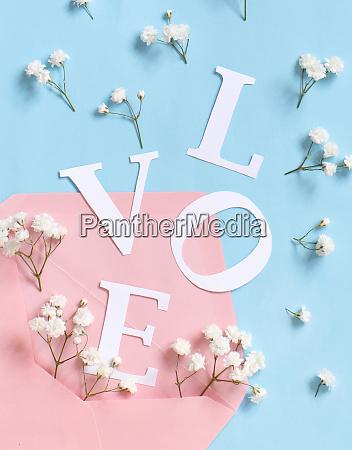 flowers pink envelope and word love