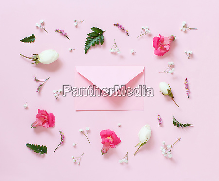flowers and envelope on a light