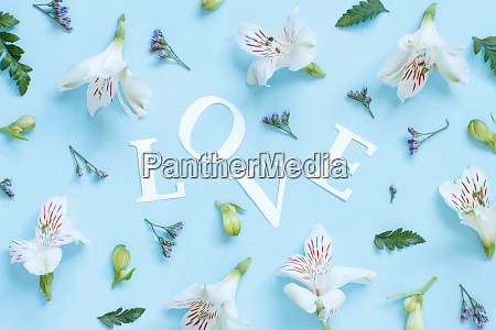 flowers petals and word love on