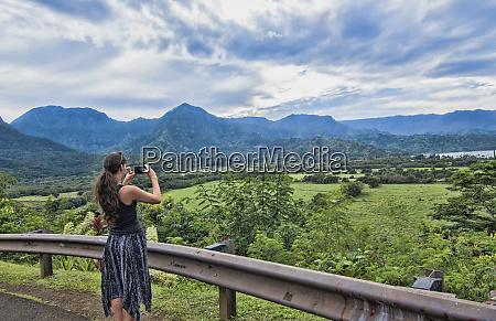 hanalei kauai hawaii woman taking video