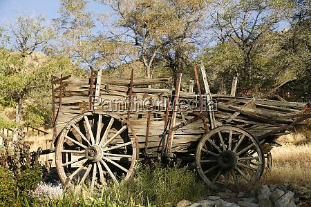 historic wooden wagon falling apart gold