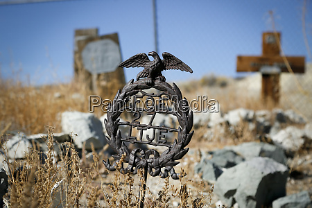 unique metal grave marker with an